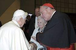 POPE BENEDICT GREETS CARD. DOLAN AND MOTHER--Pope Benedict XVI greeted US Card. Timothy Dolan of New York and the cardinal's mother, Shirley Dolan, at the end of a special audience for 22 new cardinals and their families in Paul VI hall at the Vatican Feb. 20. (CNS photo/L'Osservatore Romano via Reuters)