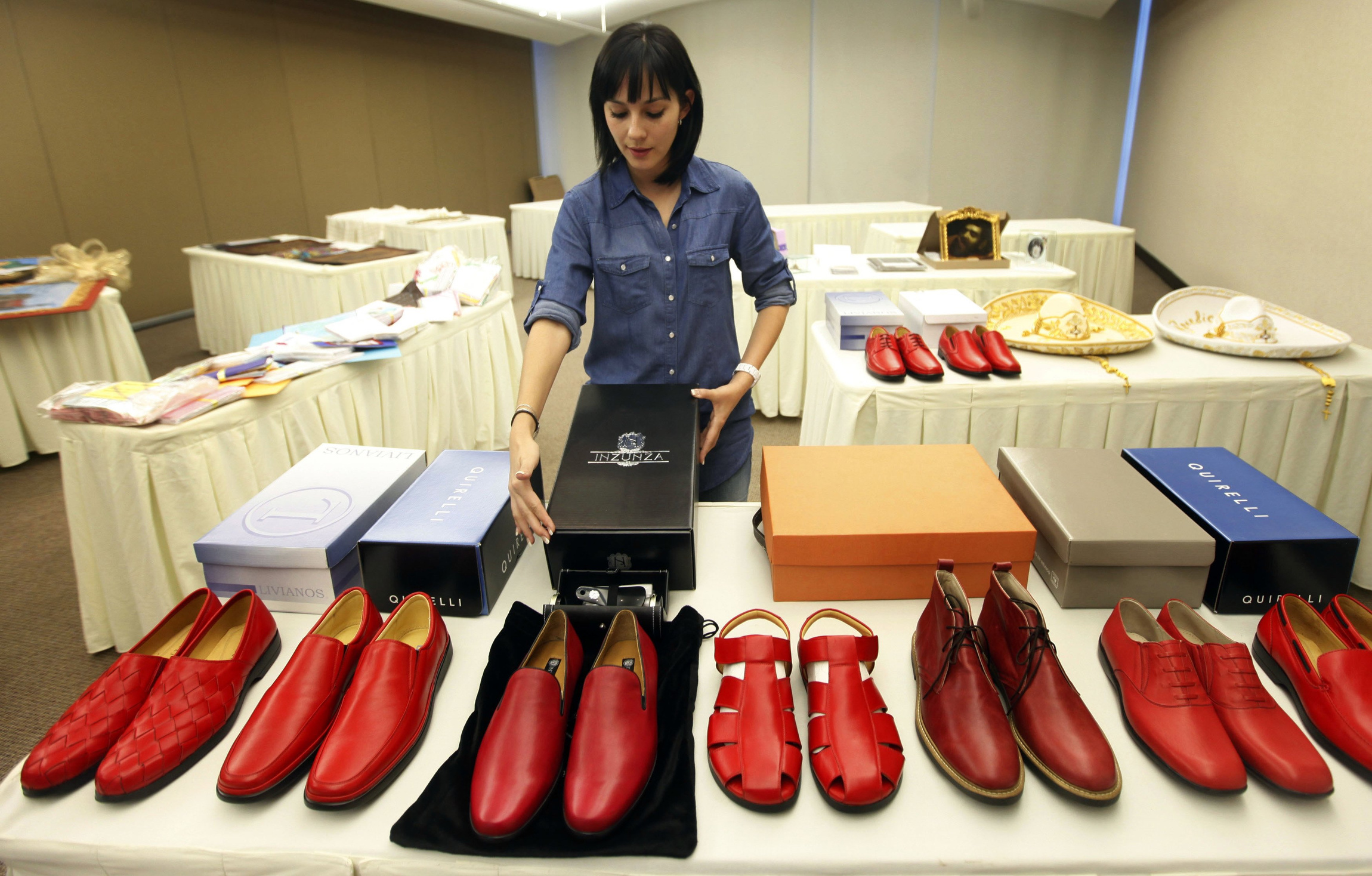 VOLUNTEEER SHOWS RED SHOES TO BE GIVEN TO POPE BENEDICT DURING ...