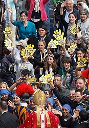 "PASSIONATE YOUTH--Young people wave signs saying ""Ciao Papa"" as Pope Benedict XVI left after celebrating Palm Sunday Mass in St. Peter's Square at the Vatican April 1. (CNS/Paul Haring)"