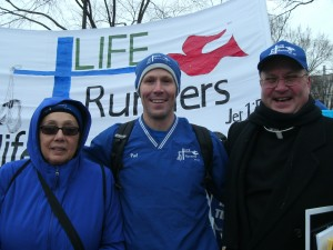 2013 MARCH FOR LIFE--Sharon Weidelman, Dr. Patrick Castle, founder and director of National Life Runners, and Fr. Vincent Bertrand posed for a photo during the 40th annual March for Life held in Washington, DC, Jan. 25, 2013. One of the many events surrounding March for Life was the Nellie Gray Memorial Life Runners 5k, named for the founder of March for Life.(Submitted photo)