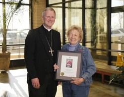 """CHARTER MEMBERS--Bp. James V. Johnston presented a framed Episcopal Blessing to Wanda Drury, a Charter Member of Catholic Charities of Southern Missouri. Charter Members """"make the love of Christ visible to those in need through their generous and vital support of CCSOMO,"""" as the Episcopal Blessing notes. Charter Membership closes Dec. 31, 2013.(Submitted photo)"""