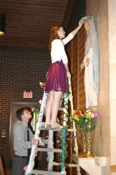 MAY CROWNING--Many schools throughout the Diocese of Springfield-Cape Girardeau held May Crownings in order to honor Mary. One such celebration was during an all-school Mass held May 2 in St. Vincent de Paul School, Cape Girardeau: Jordan Huff crowned a statue of Mary and was assisted by Jack Essner. The eighth grade class was responsible for Mass preparation. (Submitted photo)