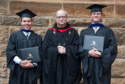 MASTER'S IN PHILOSOPHY--Two seminarians for the Diocese of Springfield-Cape Girardeau recently graduated with master's degrees from St. Meinrad Seminary and School of Theology. Pictured are Colby Elbert, Fr. Denis Robinson, OSB, president and rector at St. Meinrad, and Joseph Stoverink. (Photo by Dan Williams)