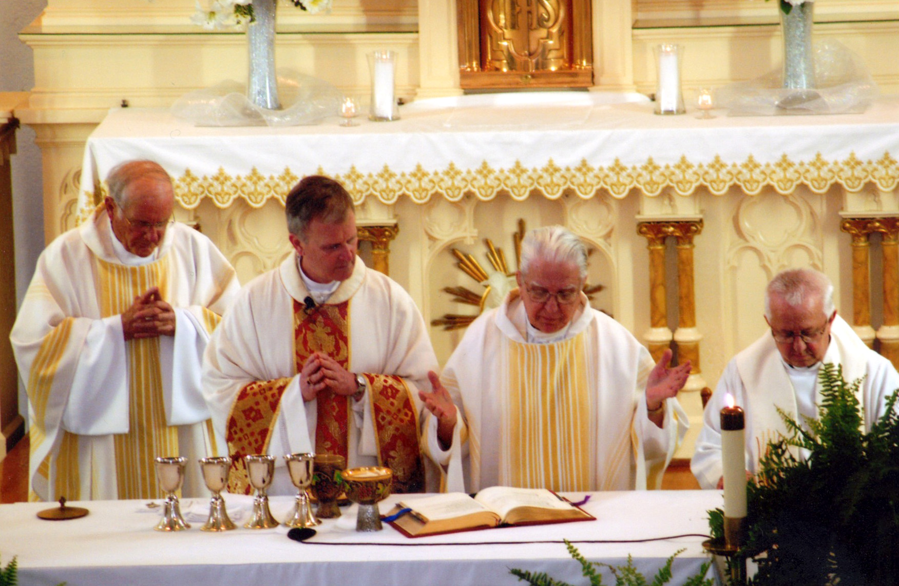 EUCHARISTIC PRAYER--Bp. Emeritus John J. Leibrecht, Bp. James V. Johnston, former St. Mary pastor Fr. Bob Landewe, and St. Mary pastor Fr. Peter Morciniec prayed the Eucharistic Prayer on the altar of St. Mary Catholic Church, Pierce City, May 4. (Submitted photo)