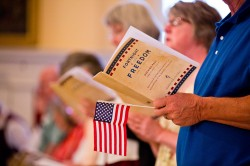 MAN HOLDS PROGRAM AND US FLAG DURING OPENING MASS FOR FORTNIGHT FOR FREEDOM AT BALTIMORE BASILICA--(CNS photo/Tom McCarthy Jr., Catholic Review)