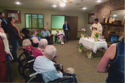 NURSING HOME MINISTRY--Residents and parishioners participated in the liturgy as Fr. Joji Vincent celebrated Mass in a Lebanon nursing home. While Catholics there receive Holy Communion on a regular basis, what has thrilled them this year is to have Mass celebrated once a month with St. Francis de Sales parishioners joining them. Sr. Mary Frances Reis, BVM, serves in pastoral care in St. Francis de Sales Parish, Lebanon.(Submitted photo)
