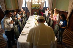 WORLD YOUTH DAY PILGRIMS STAND FOR GRACE AS THEY MEET FOR LUNCH WITH POPE FRANCIS--Twelve World Youth Day pilgrims stood with Pope Francis for grace before lunch at the archbishop's residence in Rio de Janeiro July 26. The pope showed the world on his first international trip that his forte as a communicator is the simple, seemingly ar tless action that resonates powerfully in context. (CNS photo/L'Osservatore Romano)