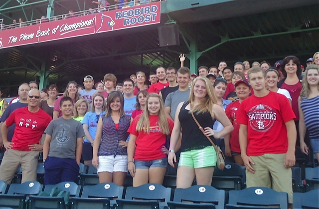 TAKE ME OUT TO THE BALLGAME--About 130 people from Webb City, Joplin, Billings, Springfield, Marshfield, and Ozark, attended Catholic Youth Night at the Springfield Cardinals on July 24 at Hammons Field.  Mass was celebrated before the game in the Springfield Cardinals Team Training Room with Bp. Emeritus John J. Leibrecht. (Photo by Adam Maddox)