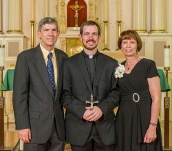 JESUIT--David Kiblinger, SJ, (center) professed first vows as a Jesuit on Sat., Aug. 17. He is pictured with his parents, Mark and Debbie Kiblinger, members of St. Vincent de Paul Parish, Cape Girardeau. (Photo by Tom Rochford, SJ)