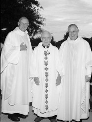 TWO BISHOPS AND A MONSIGNOR--Bishop John J. Leibrecht of the Diocese of Springfield-Cape Girardeau (left) and Bishop John Gaydos, Bishop of the Diocese of Jefferson City, MO, posed with Msgr. Syl Bauer in 2002 on the occasion of a Mass celebrating his his 60th anniversary as a priest. (The Mirror)