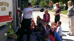First- and second-grade students at St. Lawrence Catholic School listened attentively as fire-fighters described details about the rescue truck from the Monett Fire Department on Oct. 10. Fire Prevention Week was marked Oct. 7-11, 2013. (Submitted photo)