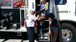 Preschool and kindergarten students at St. Lawrence Catholic School were helped from the ladder truck of the Monett Fire Department they got to explore on Oct. 10. Fire Prevention Week was marked Oct. 7-11, 2013. (Submitted photo)