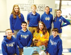 "FIRST PLACE IN STRATEGY/INNOVATION--Students at Immaculate Conception School in Jackson, MO, participated in a robotics competition that puts robots built from LEGO Mindstorm kits through an obstacle course. Under the theme of ""Nature's Fury,"" the team won first place in Strategy and Innovation at the state tournament held Dec. 8 in St. Louis.  Team Immaculate Conception's idea was a volcanic ash filtration system that ran on solar panels. (Submitted photo)"