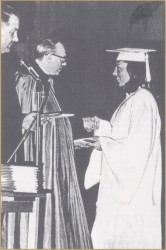 Superintendent of Catholic Schools Fr. Mark Ernstmann assists Bp. William Baum in handing out diplomas for the 1970 Catholic high school graduations in the Diocese of Springfield-Cape Girardeau