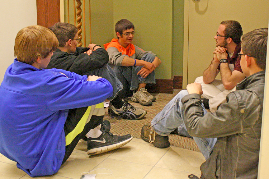 "FAITH-SHARING AND DISCUSSION—Young men from the dioceses of Springfield-Cape Girardeau and Tulsa  (right) participated in small group discussion over the topics of ""risk and conversion"" and ""joys in discernment"" with seminarian Douglas Leikam of the Archdiocese of Kansas City, Kansas City, KS, on Sat., April 5, during the Encounter With God's Call weekend at Conception Seminary College. (Photo by J.B. Kelly)"