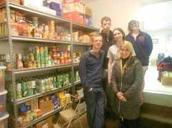 FRANCISCAN SERVICE WEEK—Notre Dame Regional High School students Brock Hammers, Caleb Kester, Edie Salter, Mollie Ross, and Reagan Kapp posed for a photo in the Jesus in Disguise food pantry at St. Denis Parish, Benton, MO. The Catholic high school's student body recently held its annual Franciscan Service Week participating in a host of service projects in the Cape Girardeau area. (The Mirror)