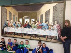 THE LAST SUPPER—Artist Ginger Miller and students in St. Vincent de Paul School, Cape Girardeau, enjoyed the unveiling and blessing of one of two murals in the school on May 14. Pictured is the mural The Last Supper. Miller, the art teacher in St. Vincent de Paul School, completed another mural for the school entitled, The Life of Christ. Diocesan seminarian, David Baunach, painted a canvas of St. Vincent de Paul, the patron of the parish and school. (Submitted photo)