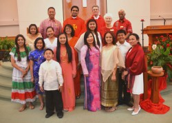 PRAYER PETITIONS—A group photo represents members of Our Lady of the Lake Parish, Branson, who participated in the call to read the prayer intentions during the June 8 liturgy in their native language and wear traditional dress from their country of origin. Languages spoken were English, by Rick Shields; Tagalog (Philippines), by Issa Avellanosa; Vietnamese, by Christine Nguyen; Sinhalese (Sri Lanka), by Rienzie Wannithantri; Chinese, by Kiara Holtkamp; and Italian, by Remy Battain. (Submitted photo)