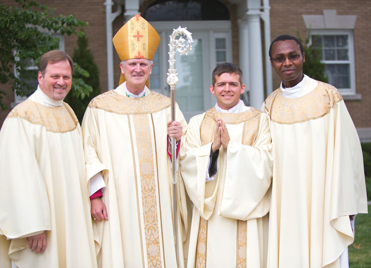 TRANSITIONAL DEACON—Fr. J. Friedel, Director of Vocations/Seminarians; Bp. James V. Johnston, Jr.; Deacon Joe Kelly, fourth-year theology student at Kenrick-Glennon Seminary​, in St. Louis; and Fr. Patrick Nwokoye, Director of Vocation Promotions, posed for a photo after Kelly was ordained to the diaconate in St. Agnes Cathedral June 21. Kelly hopes to be ordained a priest in about a year's time. (Photo by Phil Labadie)
