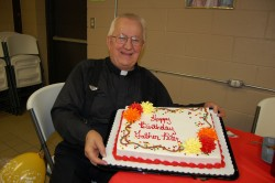 "HAPPY BIRTHDAY—Fr. Peter Morciniec celebrated his 70th birthday on Sept. 23 with students in St. Mary School, only four days before being named ""Best Pastor"" by The Monett Times. Fr. Morciniec is pastor of St. Mary Parish, Pierce City, and St. Agnes Parish, Sarcoxie. (Photo by Shelly Wrobleski)"