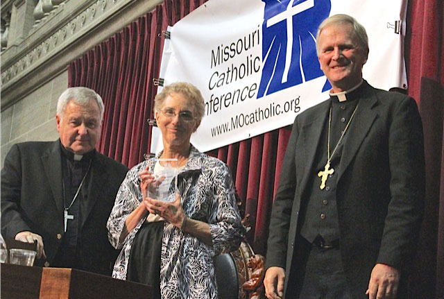 CITIZEN RECOGNITION AWARD—Abp. Robert J. Carlson of the Archdiocese of St. Louis (left) and Bp. James V. Johnston (right) congratulated Margaret Schatz on her being distinguished with the Citizen Recognition Award from the Missouri Catholic Conference at its Annual Assembly on Oct. 4. Schatz was recognized for her tenacious work in pro-life activities in the Diocese of Springfield-Cape Girardeau. (Photo by Jay Nies)