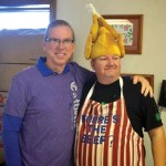 65TH ANNUAL TURKEY DINNER—Gene Koester posed with turkey-headed Mike Wilson during the 65th annual Turkey Dinner at Sacred Heart Parish, Webb City, MO, the weekend of Nov. 1-2. Over 2,000 meals were served while the community hosted a country store and silent auction at the parish fundraiser. (Submitted photo)