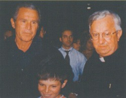 President George W. Bush and Father Peter Morciniec, pastor of St. Mary, met to survey the tornado damage and relief efforts on May 13, 2003.