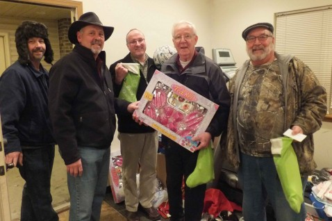 "KNIGHTS OF COLUMBUS GATHER GOODIES FOR CHRISTMAS STOCKINGS—Branson's Our Lady of the Lake Parish Knights of Columbus Council 6470 recently distributed stockings and gift cards for the ""Stockings for Christ"" program at the Branson Park Apartments. Pictured are Ron Watkins, from ""Stockings for Christ,"" and Knights of Columbus Caroll McCullough, Matt Redding, Joe Andrle, and Art Thole.  Also present but not pictured were Fred Williams and Larry Plano. (Submitted photo)"