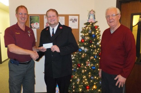 "2,400 POUNDS OF FOOD—Knights of Columbus Council 6470 Grand Knight Patrick Guidry (left) and Joe Andrle (right) presented Salvation Army Lieutenant Shawn DeBaar (center) with a check for $520. The home parish for Knights of Columbus Council 6470 is Our Lady of the Lake, Branson. The money was collected at the Knights Christmas Party rather than the usual gift exchange. ""We wanted to reach out in a meaningful way,"" Guidry said. ""Ours is a church that strives to live out the Gospel, and the Knights hope to show we care about our community.""  Lt. DeBaar said the donation will be used to purchase over 2,400 pounds of food that will be distributed to people in the area over the holidays. This is the second year the Knights of Columbus Council 6470 has assisted the Salvation Army during the Christmas season. Last year, the Knights donated numerous toys to the Salvation Army Angel Tree Program. (Submitted photo)"