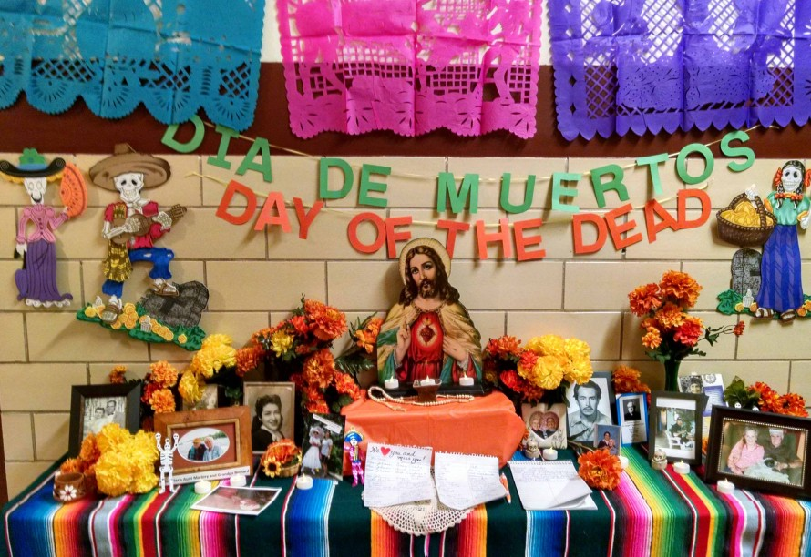 """DAY OF THE DEAD—Springfield's St. Joseph Catholic Academy (SJCA) students, faculty and staff memorialized loved ones who have gone before them with a """"Day of the Dead"""" altar on Nov. 2, 2017, All Souls Day. Students and teachers brought photos and wrote the names of those who have passed away. At the end of each day during the week, the entire school prayed together The Prayer for Eternal Rest in honor of the beloved dead. (The Mirror)"""