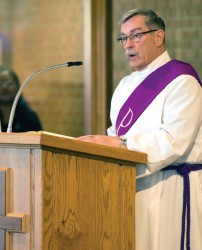 LITURGY OF THE WORD—Deacon Walter Biri preached during a recent liturgy in Immaculate Conception Parish, Jackson, MO. Permanent deacons bring a myriad of gifts to parish life and mission. (Photo by Kelly Mansfield)