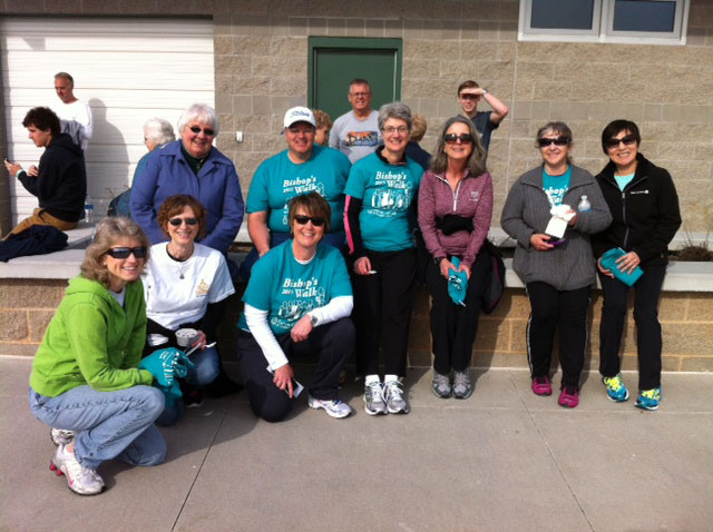 "SPRINGFIELD—Parishioners from Holy Trinity Parish, Springfield, posed for a photo after joining many walkers on the track at Springfield Catholic High School March 21 for the first annual Bishop's Walk— ""Families Helping Families."" Pictured were (front row) Mary Gray, Nancy Pikey, Cindy Bennett; (second row) Sr. Diane Frederick, OSF, Darryl Gates, Sue Gates, Lisa Spragg, Diana Mullen, Anita Gilliam; (third row) Tom Gray, and Jacob Gray. (Submitted photo)"