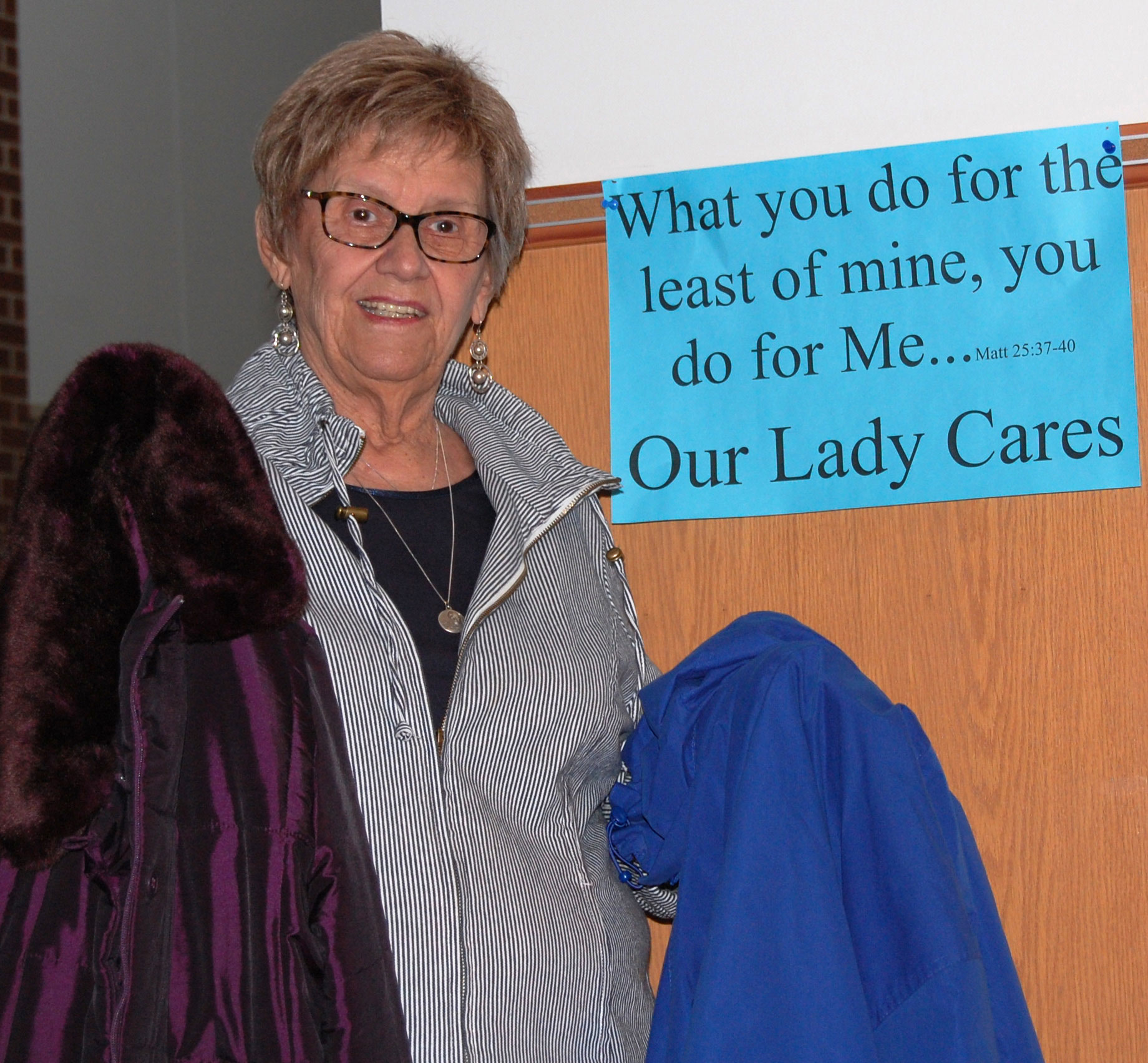 "'OUR LADY CARES'—Sharon Tangeman is the official ""coat lady"" who gathered over 800 coats plus clothing, blankets, and hygiene and health items for the ""Jesus Was Homeless"" Thanksgiving Dinner held at Our Lady of the Lake Parish, Branson. The event was supported by Our Lady Cares outreach. (Submitted photo)"