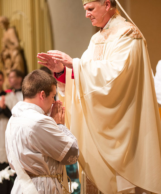PRAYER OF ORDINATION—Bishop James V. Johnston prayed the Prayer of Ordination over Joseph Kelly during the his ordination to the priesthood June 12 in St. Agnes Cathedral, Springfield. (Photo by Phil Labadie)