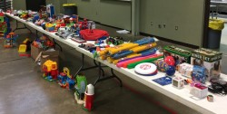 TABLES & TABLES OF TOYS—Sacred Heart Parish in Dexter recently held a Christmas Toy Drive. What was first designed to be a way for families to repurpose gently-used, or new toys for area families that might need gifts for their children, turned into a community-wide effort. (Submitted photos)