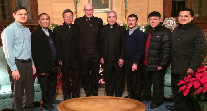 US ASSUMPTION PROVINCE—Bishop Edward M. Rice hosted leadership from the Congregation of the Mother Coredemptrix (US Assumption Province) at his residence for the annual Christmas visit on Dec. 19. Pictured with Bishop Rice are Rev. Peter M. Khuong Tran, CMC, Assistant IV - Formation; Rev. Polycarp M. Nguyen DucThuan, CMC, Assistant VI - Finance; Rev. John M. Felix Viet Luan Dinh, CMC, Assistant II - Personnel; Bishop Rice; Very Rev. Louis M. Minh Nhien, CMC - Provincial Minister; Rev. Francis M. HungLong Tran, CMC, Assistant V - Secretary; Rev. Bernardine M. Minh Tan Dang, CMC, Assistant III - Evangelization; Rev. John M. Paul Van Tai Tran, CMC, Assistant Provincial Minister. The community is headquartered in Carthage, MO. (The Mirror)
