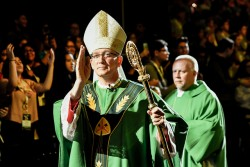 BLESSING—Bishop Edward M. Rice imparts a blessing at the Q Arena on the campus of Missouri State University in Springfield July 15. He spoke to the youth, and now each of us, on closing the gap between faith and one's life. (The Mirror)