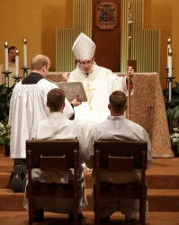 ORDINATION—Bishop Edward Rice instructed Joseph Stoverink and Colby Elbert on the role of a deacon in service to the Church. Stoverink and Elbert were ordained to the diaconate on June 10 in St. Agnes Cathedral, Springfield. (Photo by Dean Curtis/<i>The Mirror</i>)