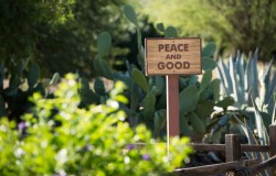 MEDITATION GARDEN—A sign greets visitors to the meditation garden at the Franciscan Renewal Center in Scottsdale, AZ. Pope Francis' long-anticipated encyclical on the environment was released at the Vatican June 18. (CNS photo/Nancy Wiechec)