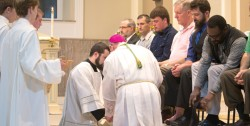 """MASS OF THE LORD'S SUPPER—Bishop Edward M. Rice washed men's feet during the Mass of the Lord's Supper, which began the 2017 Easter Triduum. Holy Week, particularly the Easter Triduum, is rich with tradition and mystery. The Holy Thursday Mass recalls the Last Supper during which the Lord Jesus gave his body and blood under the species of bread and wine. The washing of feet this day represents the service and charity of Christ, who came """"not to be served, but to serve"""" (Mt 20:28). Holy Thursday also recalls the institution of the sacred priesthood.(Photo by Harrison Backer/MThe Mirror)"""
