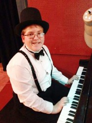 "SIXTH-GRADE PIANIST—The piano stylings of six-grader Cooper Hornbeck entertained the crowd at the Feb. 27 ""Dancing with the PB Stars"" fundraising event for Sacred Heart Catholic School. (Photo by Daily American Republic)"