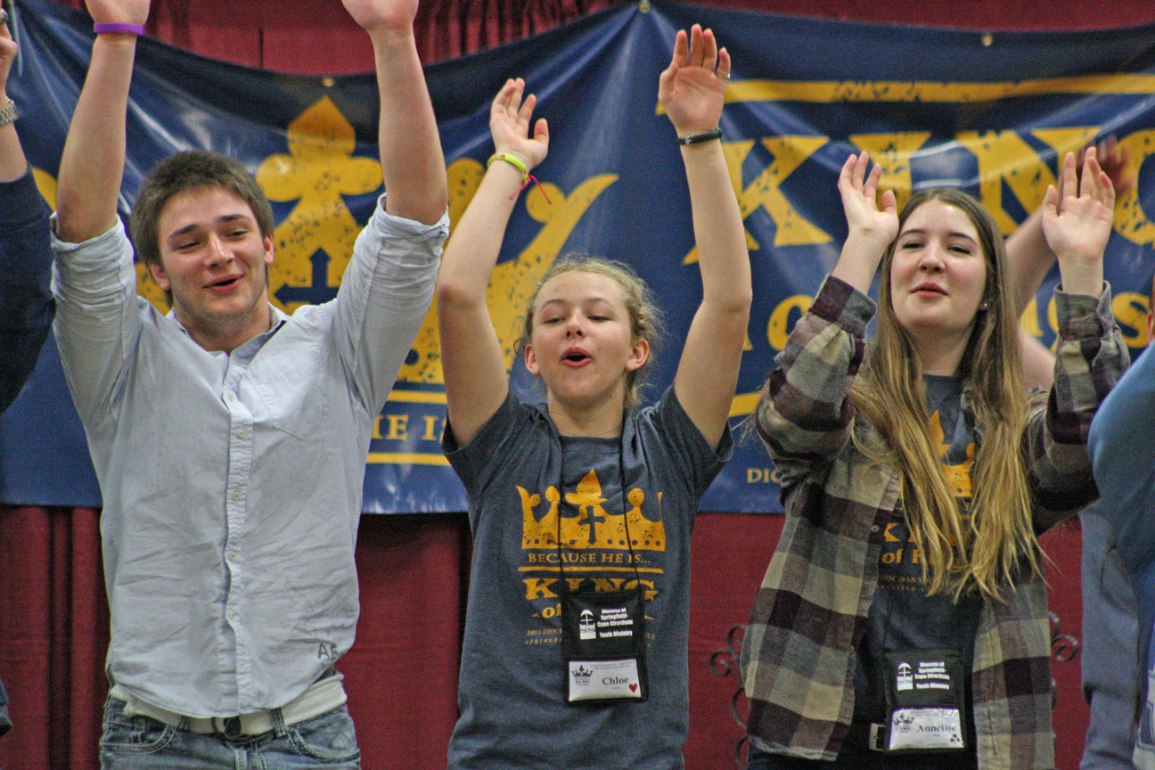 ​2015 DiOCESAN YOUTH CONFERENCE—​Youth participate​d​ in music-and-action sequences led by the Cooper Ray Band during the ​22nd Annual ​Diocesan Youth Conferece in West Plains the weekend of March 27-29.  Ray captivated a crowd of more than 300 ​high-school ​youth during his series of keynote presentations, speaking on the diocesan ​vision​ of 'loving Jesus, serving Jesus, and sharing Jesus.'​ (Photos by J.B. Kelly)​