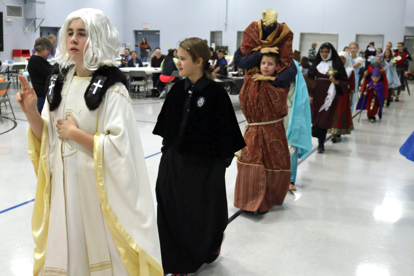 'SAINTS GO MARCHING IN'—The 'saints go marching in' at St. Joseph the Worker in Ozark for the enjoyment of parishioners and judges' viewing before awards were given for best costumes on Nov. 1. (Photo by J.B. Kelly/The Mirror)
