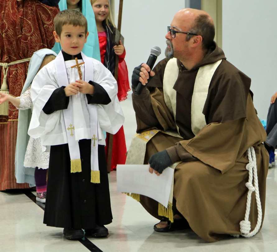 """ST. FRANCIS OF XAVIER—First place winner of the Third Grade and Younger category of costume judging, John Francis Kelly took on the persona of St. Francis Xavier and spoke with pastor Fr. Scott Sunnenberg during the """"March of the Saints"""" Party held Nov. 1 at St. Joseph the Worker Parish, Ozark. (Photo by J.B. Kelly/The Mirror)"""