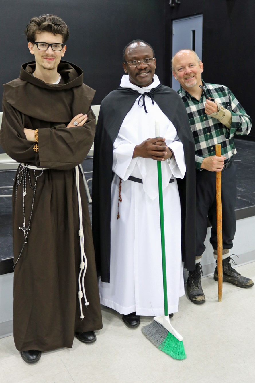 """ADULTS GET INTO THE SPIRIT—Kaleb Abraham (Bl. John Duns Scotus), associate pastor Fr. Samson Dorival (St. Martin de Porres), and John Newton (Bl. Pier Frassati) were among the adults who participated in the costume contest at the """"March of the Saints"""" Party at St. Joseph the Worker in Ozark on Nov. 1, the Solemnity of All Saints. (Photo by J.B. Kelly/The Mirror)"""