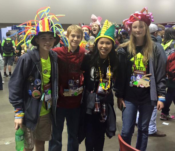 TRADING SOUVENIRS—Youth from St. Mary Parish, Joplin, traded items during a fellowship period at NCYC. (Submitted photo)