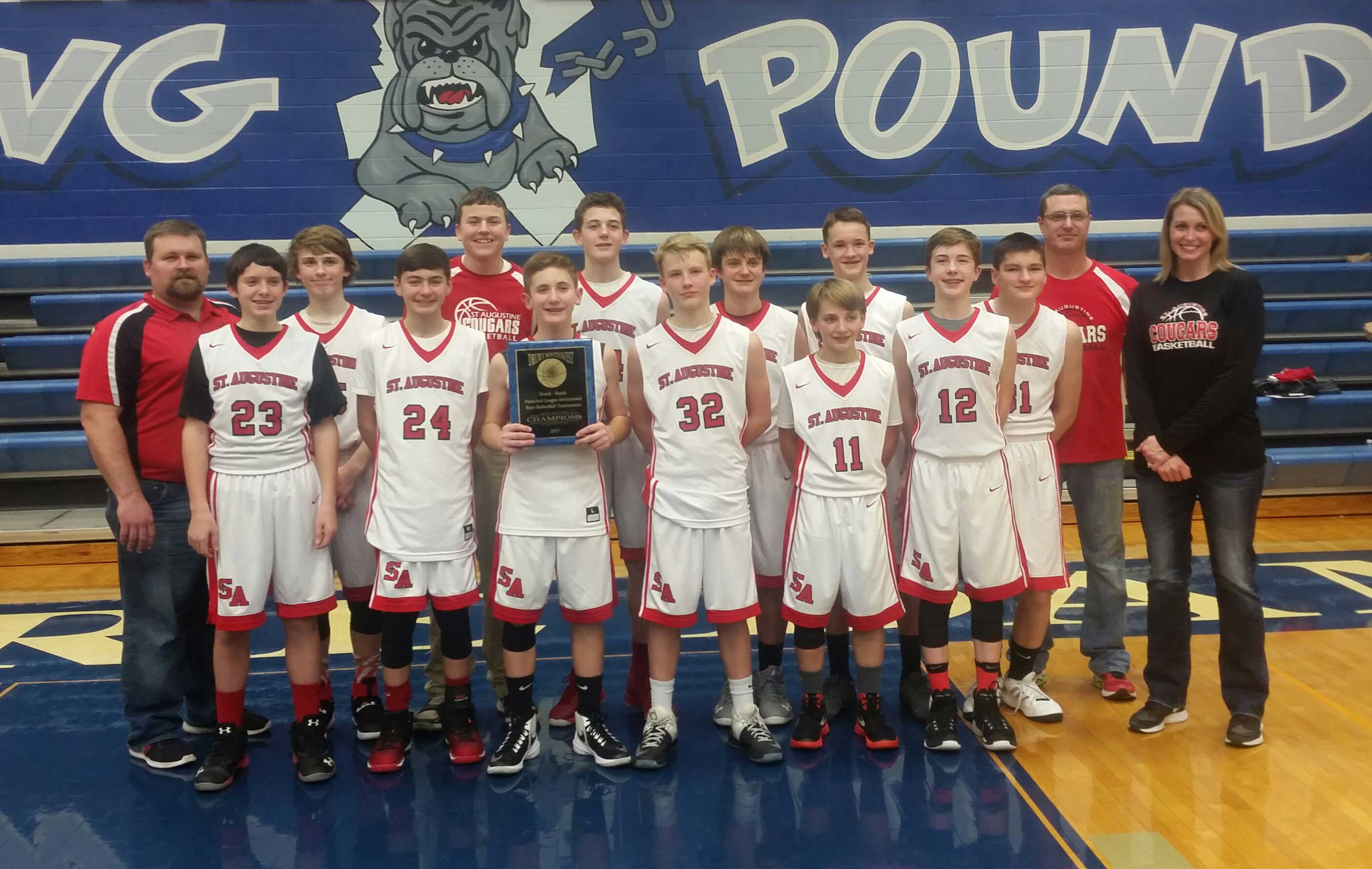 BLUE RIBBON TEAM—St. Augustine School Cougars from Kelso, MO, earned the First Place Championship in the 2017 Notre Dame Junior High Invitational Tournament held Jan. 7-8 and Jan. 14-15. Pictured were (front row) Drake Schlosser, Evan Boyd, Caleb Burger, Drew Dirnberger, Dawson Menz, and Brock Hulshof; (back row) Coach Allen Collier, Ty Collier, Cayden Beussink, Caleb LeGrand, Stetson Harris, Owen Beussink, Sam Brucker, Coach Brian LeGrand, and Coach Jill LeGrand.(Submitted photo)