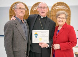 "61 YEARS OF MARRIAGE—Bernard and Dorothy Kluesner posed for a photo with Bp. Edward Rice during the Diocesan Wedding Anniversary Celebration Feb. 19 in St. Mary of the Annunciation Cathedral, Cape Girardeau. The Kluesners shared the ""Longest Married Couple"" distinction with Bill and Mary Loos. Photos of this event in Cape Girardeau may be found HERE. Photos of this event in Springfield may be found HERE. (Photo by Harrison Backer/The Mirror)"