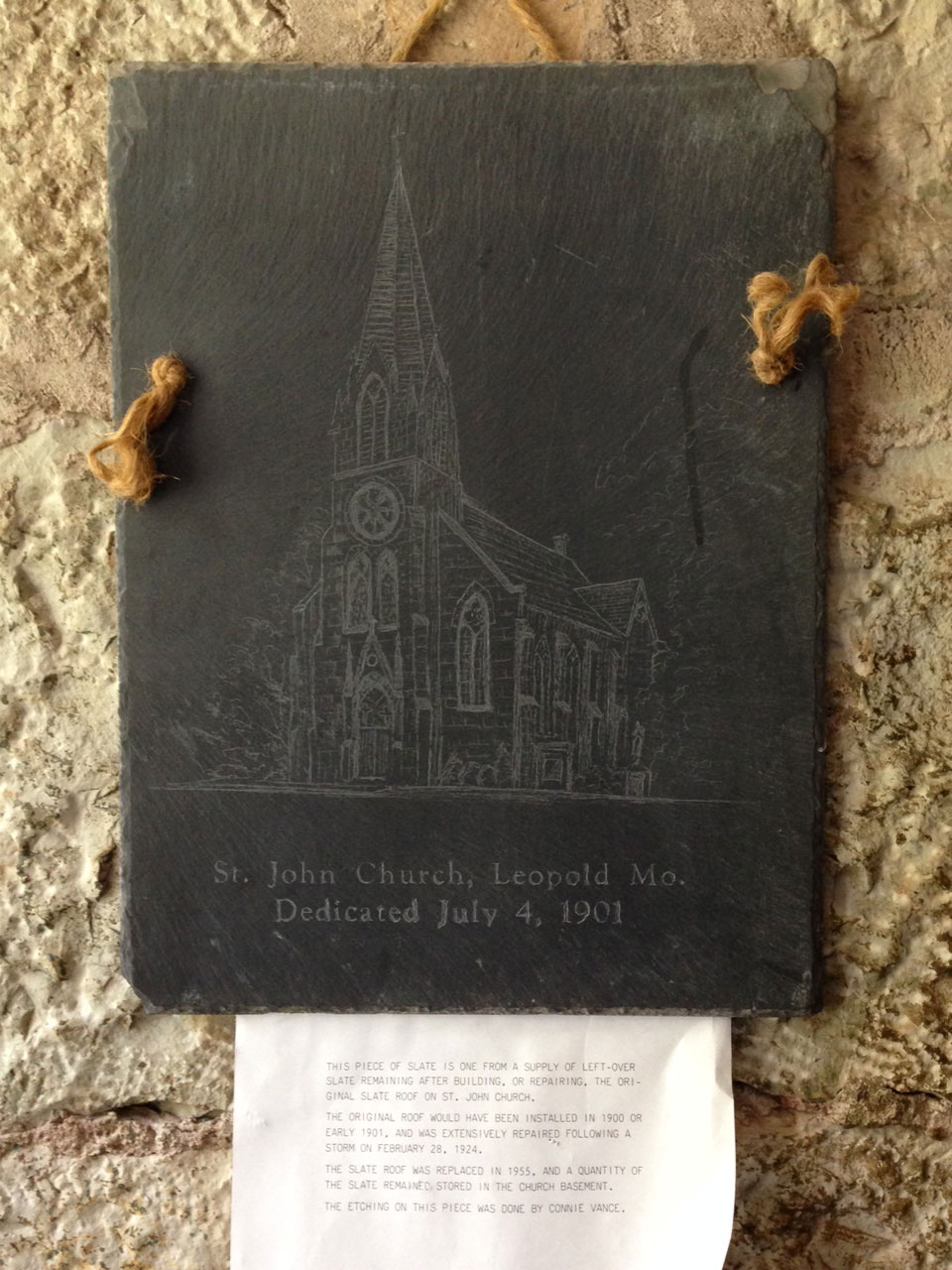 ORIGINAL SLATE—An engraved piece of the original slate inside of St. John, Leopold, Aug. 13, 2015. (Photo by Glenn Eckl)