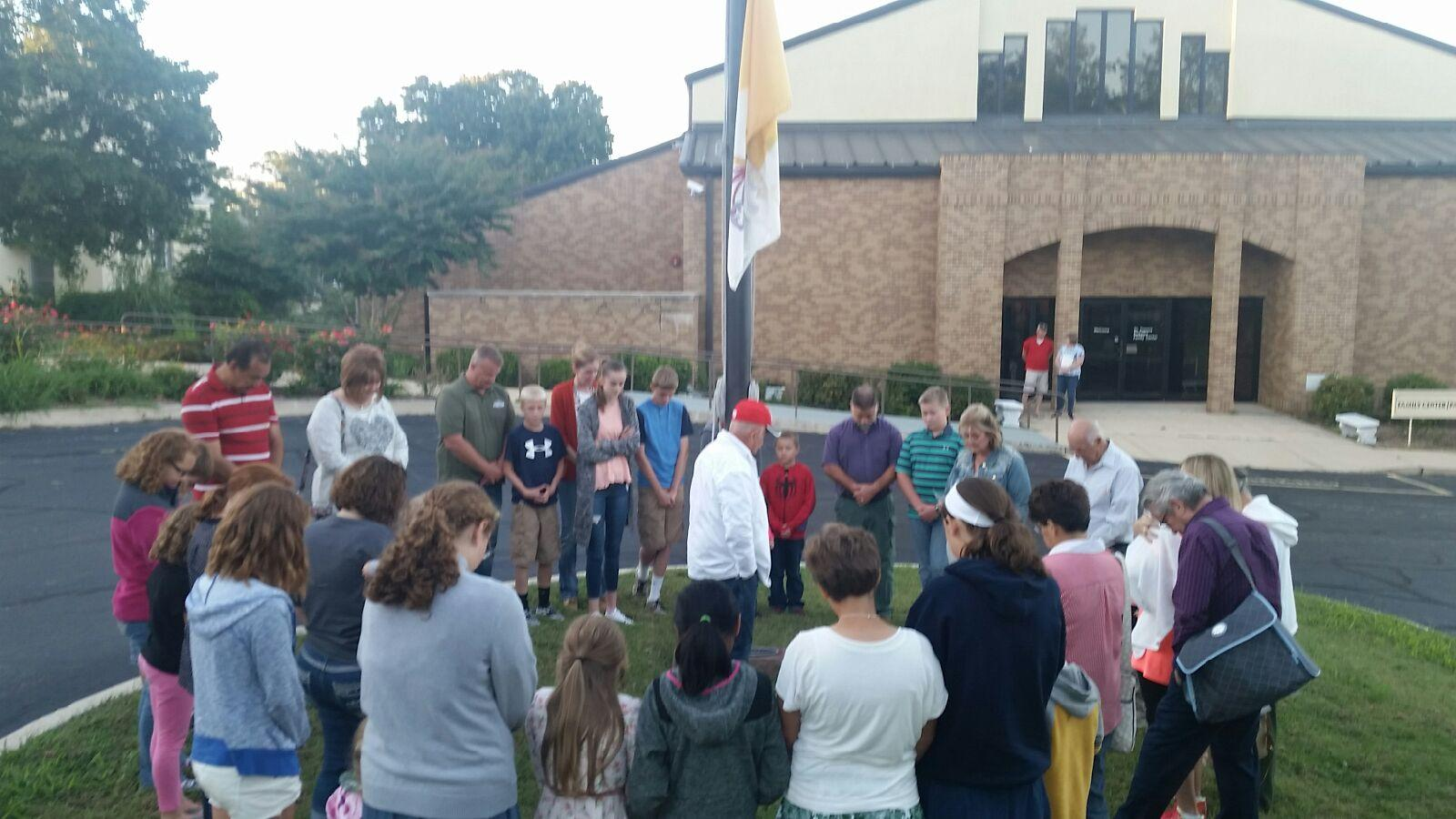 SEE YOU AT THE POLE—Parishioners at St. Francis de Sales Parish, Lebanon, gathered at the flagpole on Sept. 28 to pray for the nation and its families and leadership. (Submitted photo)